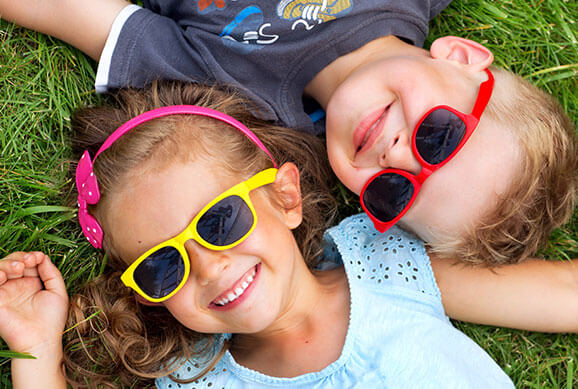 Kids with Glasses Smiling - Pediatric Dentist in Highlands Ranch, CO