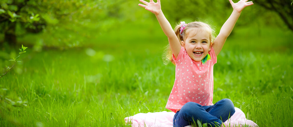 Girl Arms in Air - Pediatric Dentist in Highlands Ranch, CO